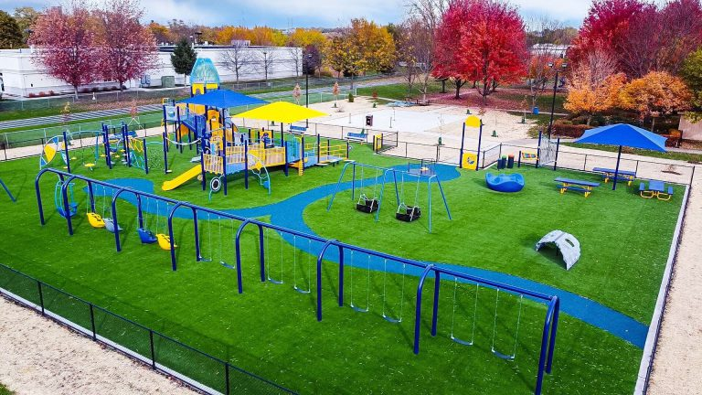 Why is artificial turf ideal for commercial playgrounds & play areas?